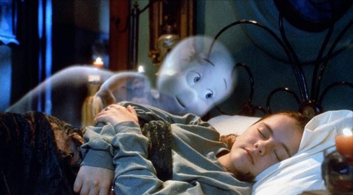 Casper in bed with Kat watching her sleep