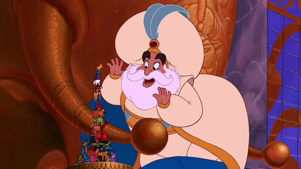 Aladdin (1992) Sultan playing with toys like a man-child
