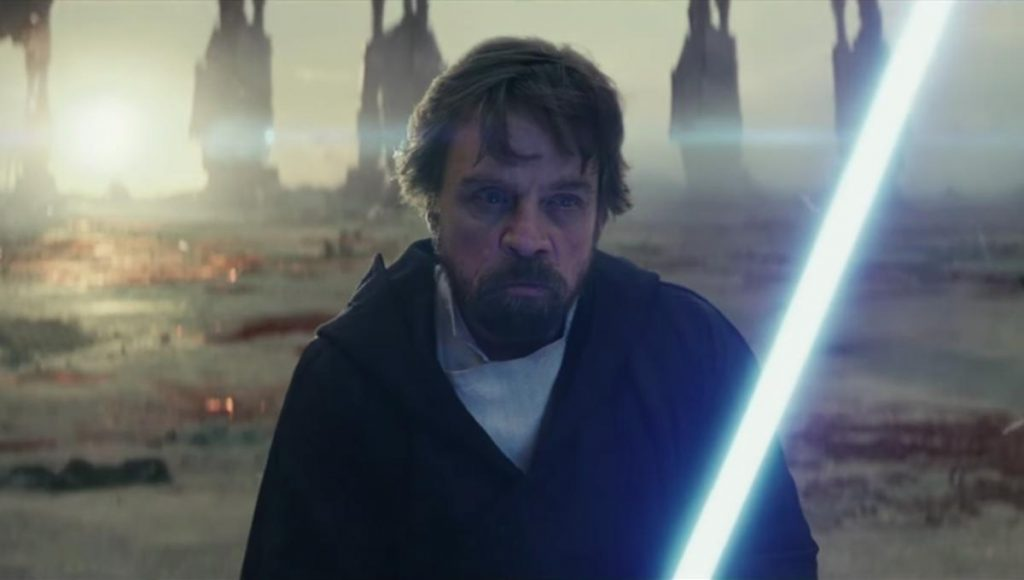Luke holding his light saber in the Last Jedi