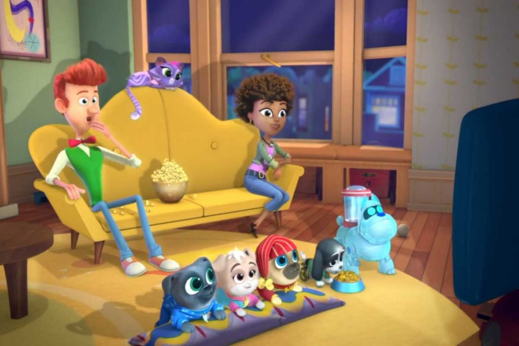Bob and puppies watching a movie and eating popcorn in Puppy Dog Pals